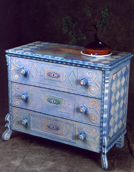 This blue hand painted pine chest is a work of art! Love the harlequin pattern on the side.