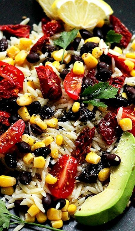 Southwestern Orzo Salad ~ Orzo Pasta mixed with sweet corn, black beans, tomatoes, avocado, and tossed with a simple and delicious Lemon Vinaigrette. This is really, reeeeeally good!