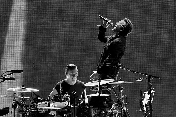 "Bono Larry Mullen Jr Photos - (This image was converted to black and white) Drummer Larry Mullen Jr. (L) and Singer Bono of the band U2 perform during U2 ""Joshua Tree Tour 2017"" at MetLife Stadium on June 28, 2017 in East Rutherford, New Jersey. - U2 Joshua Tree Tour 2017 - East Rutherford, New Jersey"