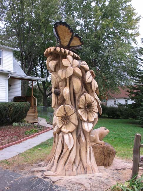 Chainsaw sculpture from Iowa - Mckinley flowers