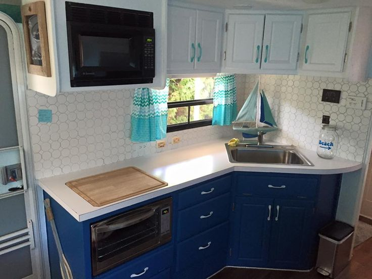Our beach themed RV remodel. New kitchen that has had the cabinets repainted, new counter top and tile back splash.