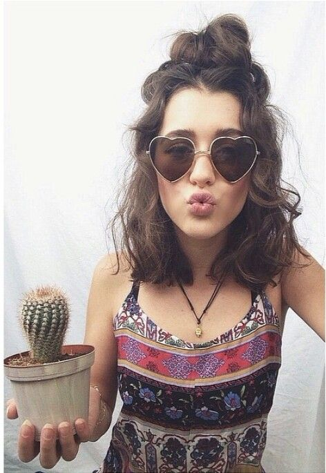 Love everything that constitutes the picture especially the cactus plant with the heart shaped sunglasses and that hair!