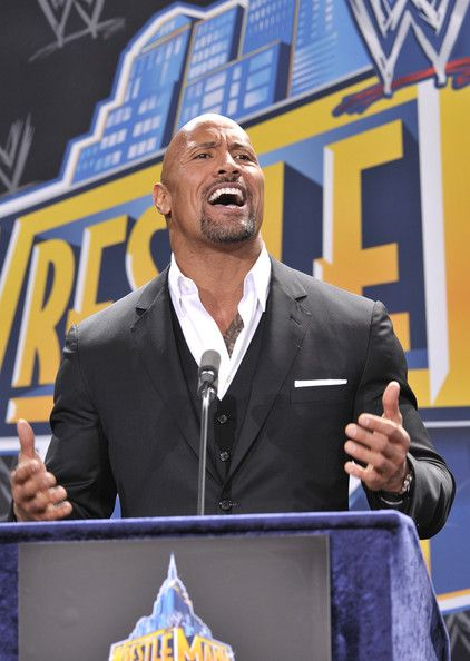 "Dwayne Johnson Photos Photos - Dwayne ""The Rock"" Johnson attends a press conference to announce that MetLife Stadium will host WWE Wrestlemania 29 in 2013 at MetLife Stadium on February 16, 2012 in East Rutherford, New Jersey. - Press Conference To Announce A Major International Event At MetLife Stadium"