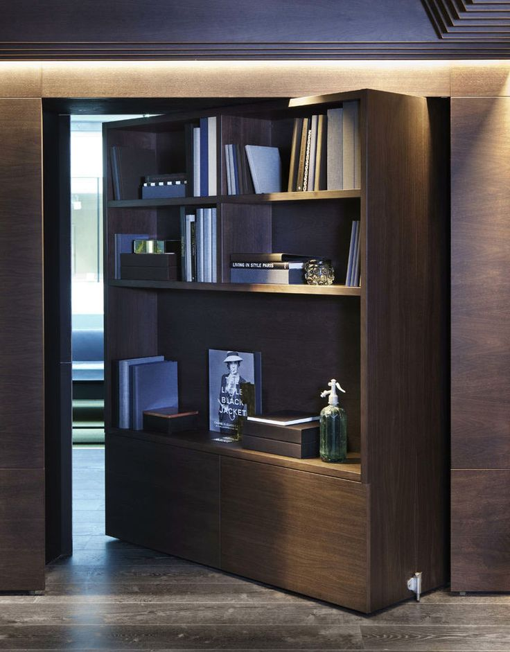 This large pivoting wood bookshelf in an