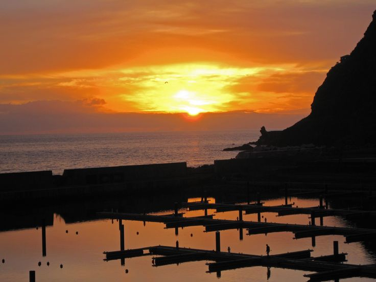 Romantic Madeiran sunset seen from the patio of this oceanside villa. Madeira, Portugal homes for sale.