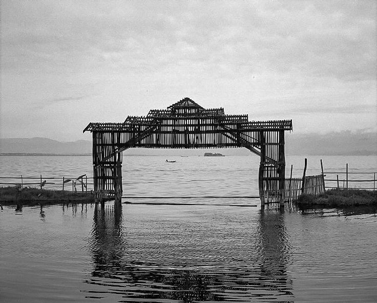 Photo by @chien_chi_chang/@magnumphotos Isolation or reform dark or light Inle Lake in Shan State Myanmar (Burma) appeals to tourists wanting to see a land less touched by modernity. In June 2015 it becomes the Myanmar's first designated place of World Network of Biosphere Reserves. #InleLake #Heho #Myanmar #fisherman #cccontheroad #cccJetLag by natgeo