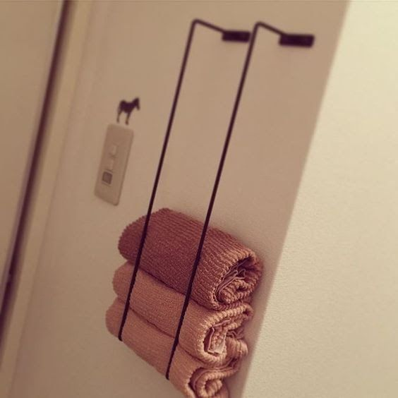 Japanese towel rack hack. Hang them vertically to store bathroom towels. genius!