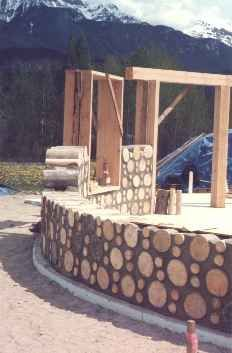 how to- notice the header is longer than the window...I assume for weight bearing - Green Home Building: Article about Cordwood Masonry