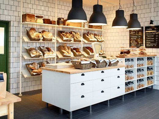A Bakery With White Display Shelves And Storage In White/solid Birch