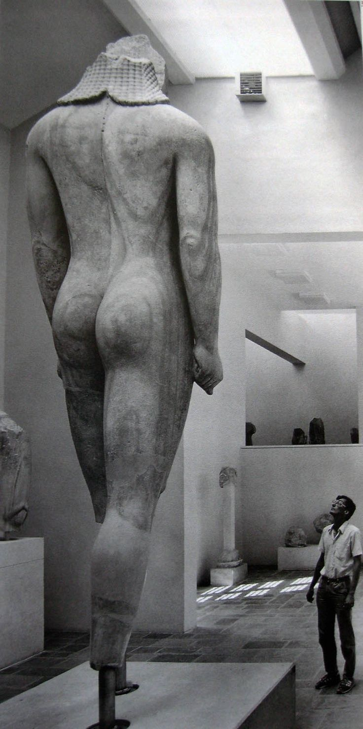 """""""The Kouros of Samos"""" marble statue - The Kouros stands nearly 5.5 meters tall, from ancient Greek area, circa 6th c. BCE,  by a Samian artist, excavatied on the Sacred Way in the Heraion in Samos Island -  at the Samos Archaeological Museum"""