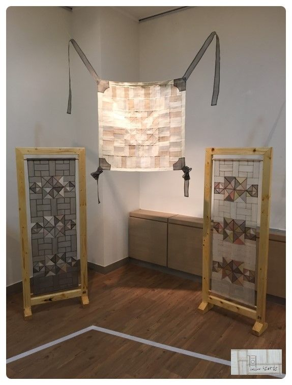 Look at the mounting in panels! Kim Djinsuk, in a Korean exhibit of one year's work by a pojagi study workgroup. A copy of an old textile hangs in the center, with her modern interpretations in the frames.
