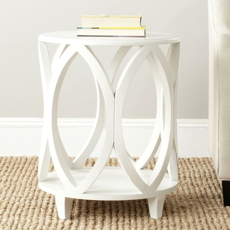 With its stylish modern geometric shape crafted of poplar wood in off white finish, the Janika accent table brings chic, organic style to any room.