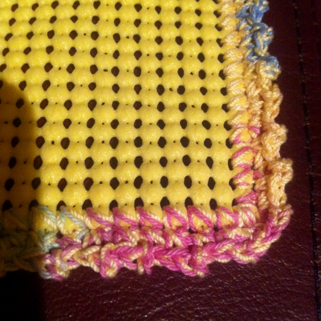 Use a rubber anti slip material and crochet the edges. Use it to open stubborn lids