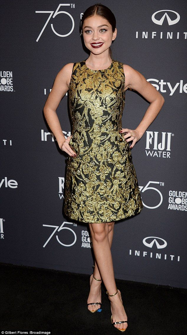 Golden girl! Sarah Hyland was dazzling in a sleeveless gold and black frock during Wednesd...