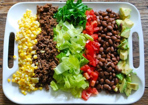 For Taco Salad.  Make a few them (I'd say one for every six guests) and scatter them over a buffet table with bowls of Monterey Jack cheese, flavoured sour cream (think chipotle, lime and cilantro), tortilla chips, limes, jalapenos, salsa and possibly even tortilla bowls.