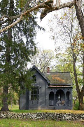 the gray slate paint makes this cute cottage in rhinebeck look gothic & adorable at the same time.