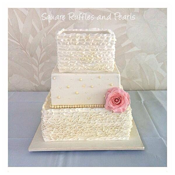 Square wedding cakes can make a nice change from the more traditional round cakes..