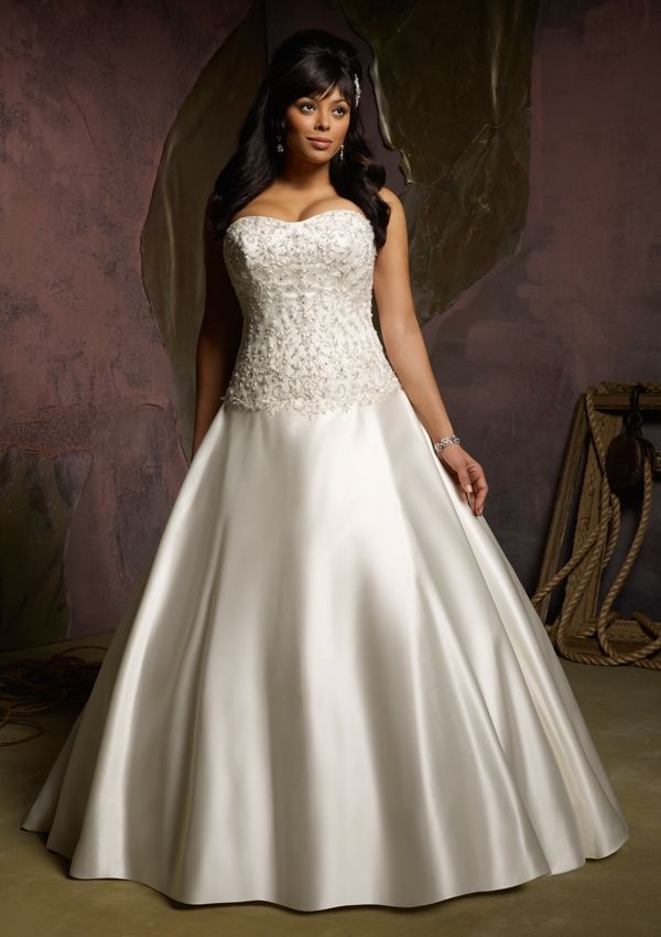 Gorgeous modern take on a traditional style; plus sized, princess-style, satin, ball gown with a beaded corset bodice.