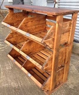 storage unit made from 1930s shoe last bins