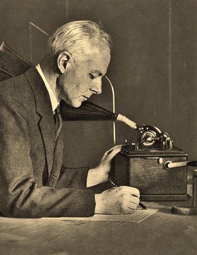 Bartok transcribing his phonograph recordings of folk songs