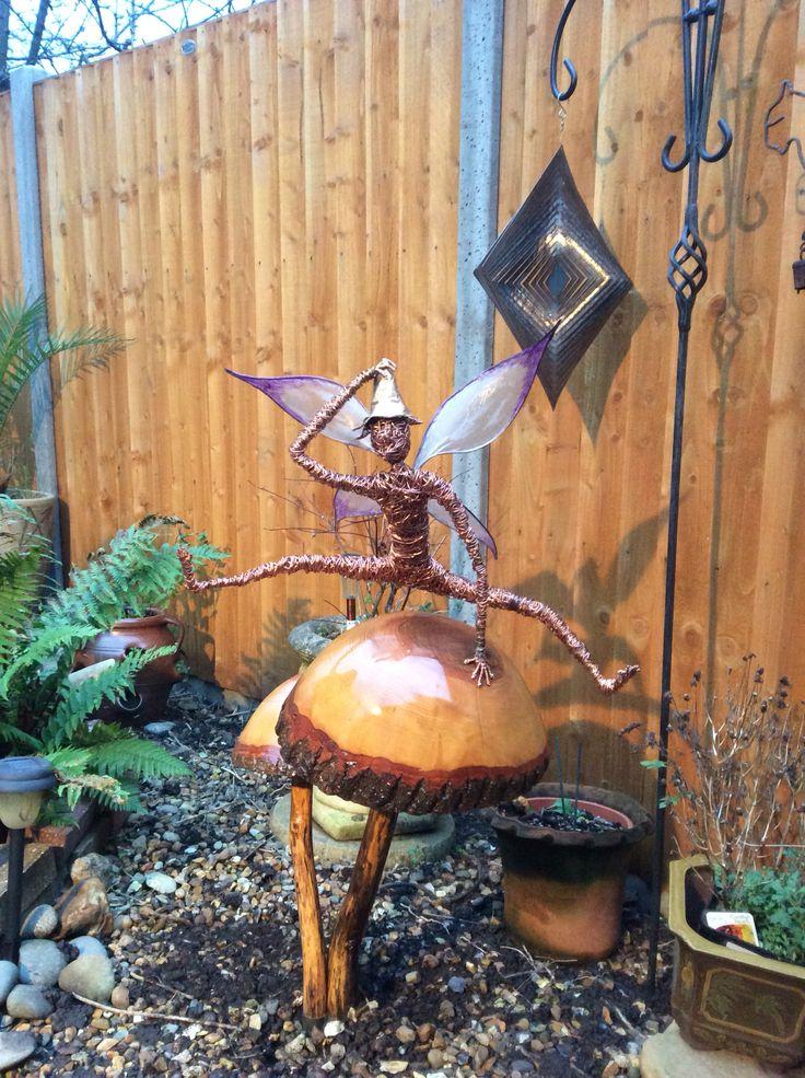 Leap frog fairy sculpture