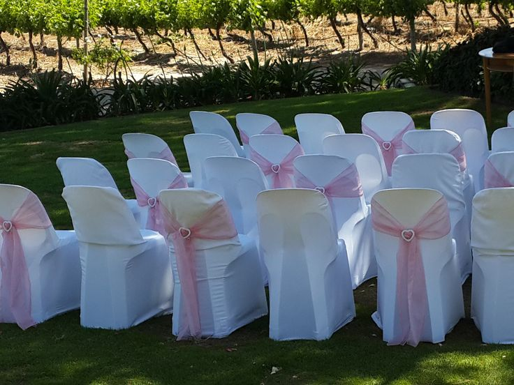 Chair covers with pink tie backs with diamante heart buckle