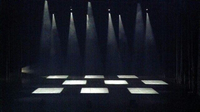 The chess board looking lighting set up is special because of its unnatural top light design.
