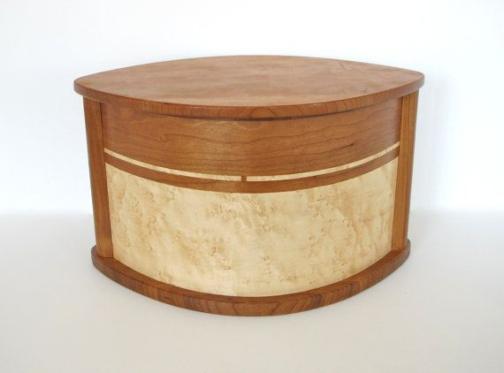 Simple and elegant wooden urn made of solid cherry and decorated with cherry and Birdseye maple inlay