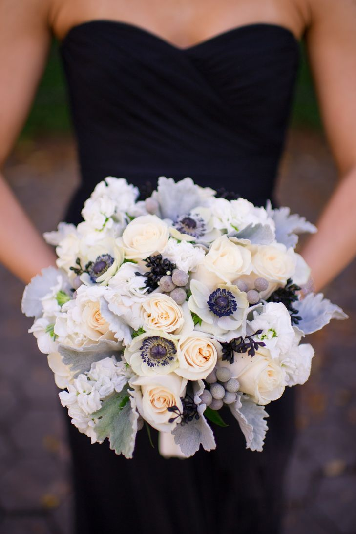 Love the anemones, lightly tinted roses, berries, and dusty miller. Would like less of a round shape