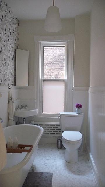 Nice small bathroom, corner vanity.