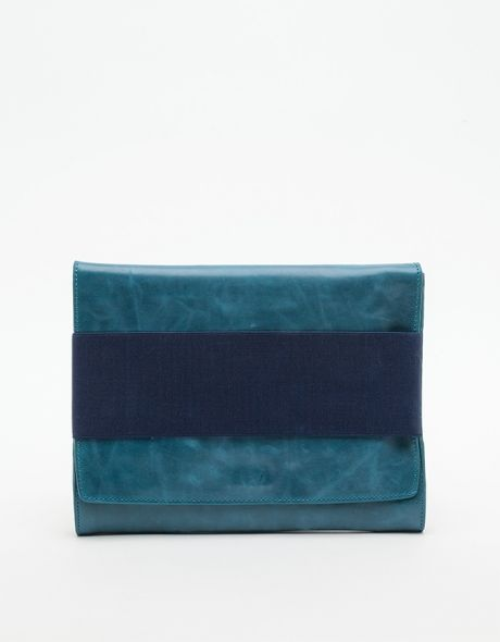 Smooth bovine leather fold over clutch bag from Wood Wood with wide elastic band closure that also serves as a carry handle.