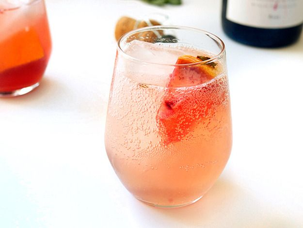 Sparkling Grapefruit Sangria     15 fresh mint leaves     1/4 cup simple syrup     1 cup fresh grapefruit juice, from about 2 Ruby Red grapefruits, plus 1/2 of one grapefruit, peel intact, cut into rough chunks     1 cup Lillet Rosé     1 bottle Cava, chilled