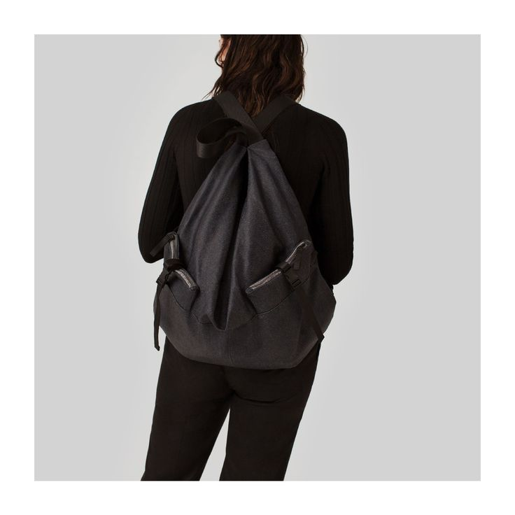 Do the twist. The crossover straps of the Ganges rucksack (seen here in a hardwearing coated denim) are inspired by the traditional Japanese furoshiki - a traditional cloth that is still used across Asia for wrapping everyday items