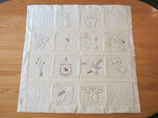"CE772 - Latte Candlewick Quilt Blocks 8""x8"" Hoop These Quilt Blocks are stitched in the popular ""coffee"" shades. The quilting stitch which is done last is matched to the cream fabric. A lovely combination! An accent block has been included in this set which can be stitched out several times for you to create a really large quilt should you wish to. I used the accent blocks for the corners to make a lovely wall quilt. http://tinyurl.com/hhytxc9"