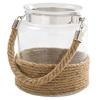 Our Rustic Lantern Centerpiece is a large glass jar with a burlap rope wrapped around the bottom and as a handle.