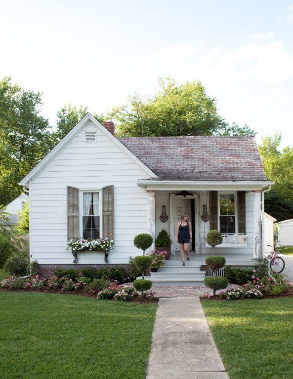 Small house curb appeal dreaming of a little white farmhouse love the extended brick flower box and garden