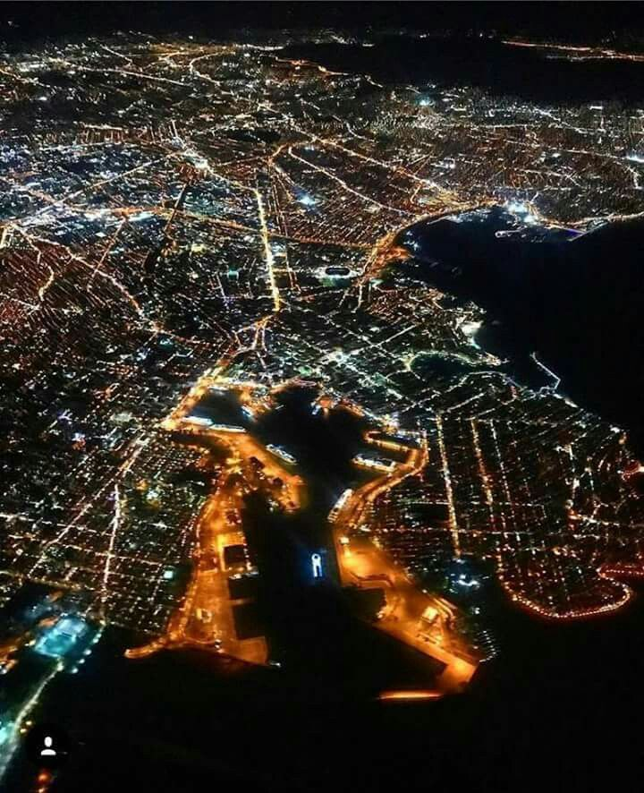 The city and the port of Pireus at night from above.