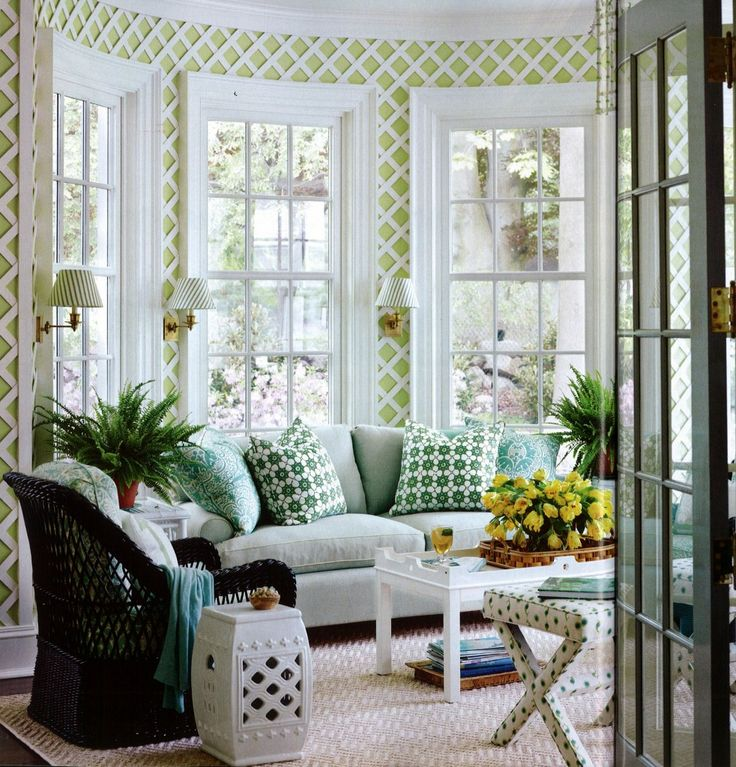 Lattice in the sunroom with wall-mounted reading sconces ...