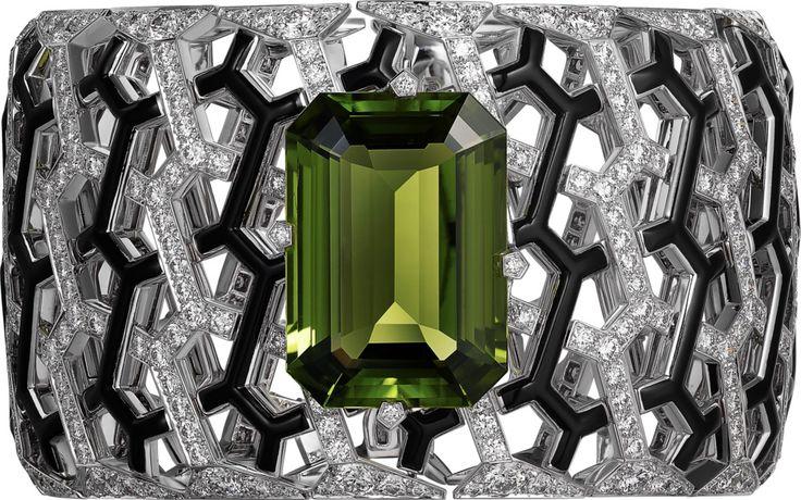 CARTIER. Bracelet - white gold, one 34.66-carat rectangular-shaped peridot, black lacquer, brilliant-cut diamonds. #Cartier #CartierMagicien #HauteJoaillerie #FineJewelry #Peridot #Diamond