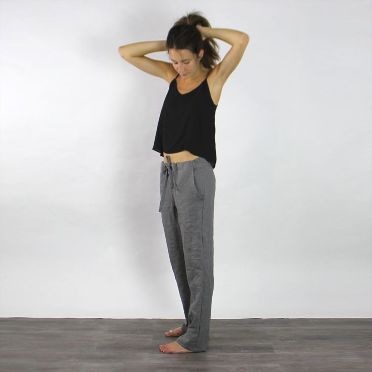 Made of linen, this loose pair of pants is comfy and easy to slip on when running into a nice weather and can be shaped at the waist by a tie band.