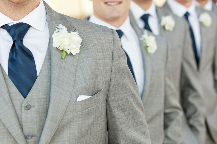 Gray suit with blue tie for the groomsmen