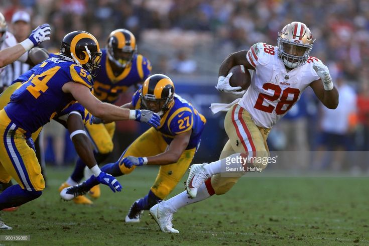 News Photo : Carlos Hyde of the San Francisco 49ers eludes...