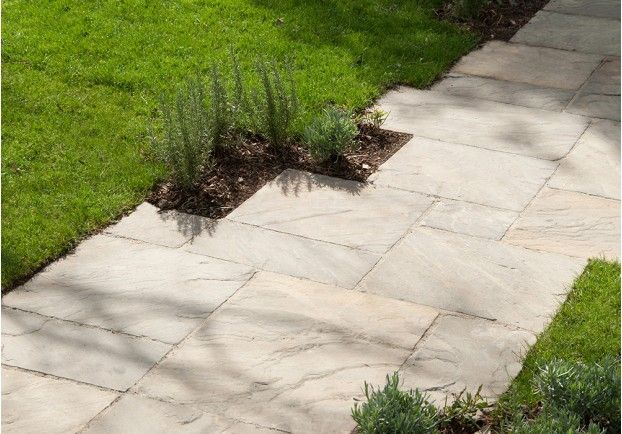 Our Millstone Grey Pavers has been laid to the rear of our Cotes Mill showroom. The subtle grey tones look stunning against the surrounding turf and flowers.