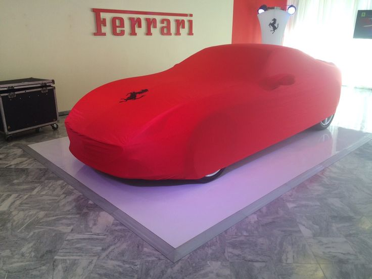 A sleek high gloss white ABS floor finishes off a sleek (& no doubt high gloss) Ferrari in Cape Town - installed for The Green Catering Company in March 2015
