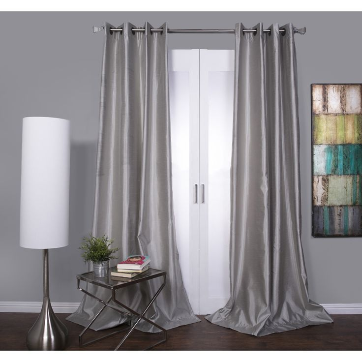 Update your home decor with this pleasant textured faux silk Mia window panel. This durable window treatment features a modern grommet style panel. An attached microfiber backing helps block adequate sunlight and offers a beautiful fall.