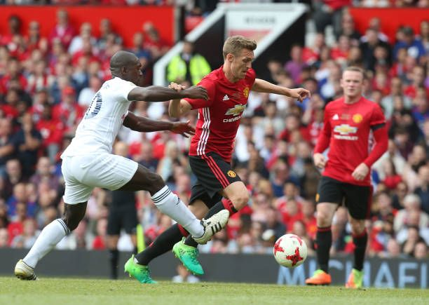 Darren Fletcher of Manchester United '08 XI in action with Clarence Seedorf of Michael Carrick AllStars during the Michael Carrick Testimonial match...