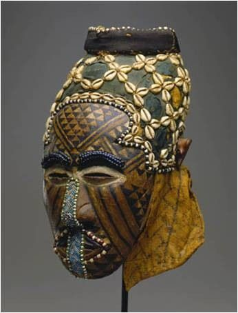 Kuba Royal Mask (Congo / Central Africa): Ngady Mwaash. This mask represents the incestuous sister-wife of Woot. Woot is a supernatural being who named animals and other things. Material: Wood, basketry, cloth, fur, grass, beads, copper sheets, cowrie shells.