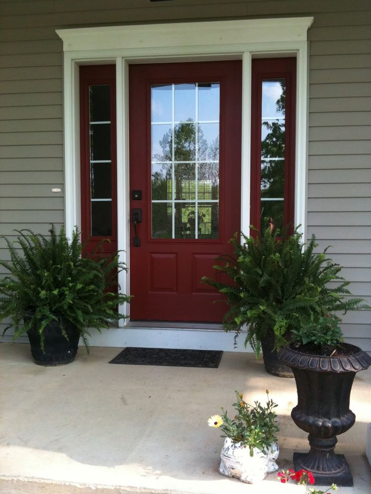 Love the red door!  And the potted ferns flanking each side.