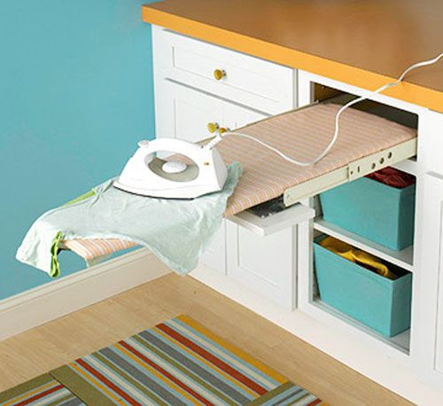 Laundry Room Ideas: Adding a pull out ironing board in the laundry room saves floor space and it's ready whenever you need it.