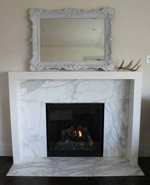 The Granite Gurus: Calacatta Gold Fireplace by MGS by Design